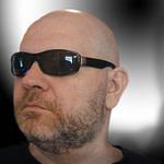 man with beard using glasses
